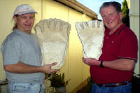 Greg and Rex Holding Casts