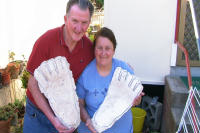 Rex and Heather holding Casts